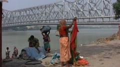 Indian woman and children in the Ganges in India Stock Footage