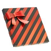 Wrapped gift box with a bow and ribbon - stock photo