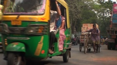 Rickshaw and bike in India Stock Footage