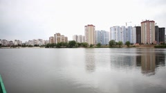 Apartment buildings reflected in lake Stock Footage