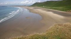 Rossili beach The Gower peninsula Wales UK PAN Stock Footage