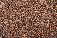 Coffee bean surface as a background Stock Photos
