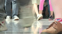 Young Feet on floor in mall or event environment - stock footage