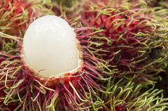 rambutan fruit tropical close up sweet red Thai concept - stock photo