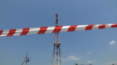 Telecommunication tower against the blue sky - stock footage