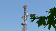Telecommunication tower against the blue sky Stock Footage