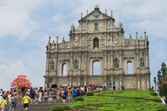 Stock Photo of Tourists visit ruins of Saint Paul cathedral in Macau, China.
