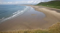 Rossili beach The Gower peninsula Wales UK Stock Footage