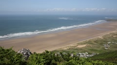 Rossili beach and coast The Gower peninsula Wales UK PAN Stock Footage