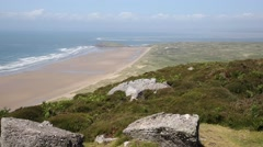 Elevated view from Rhossili Down to te beach The Gower peninsula Wales UK Stock Footage