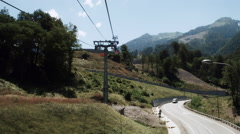 The movement of the cable car up. Rosa Khutor Plateau. - stock footage