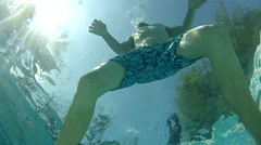 Man in a pool shot from below Stock Footage