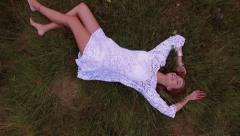 Stock Video Footage of Teenage girl in boho fashion lying in grass