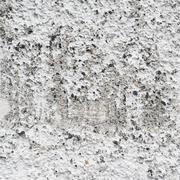 Bumpy concrete wall fragment - stock photo