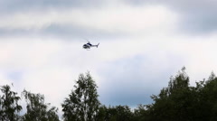alarming helicopter flying over the forest - stock footage