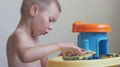 Boy playing with toys Stock Footage