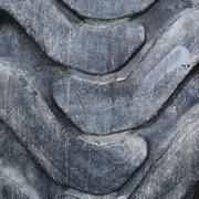 Threadbare tire surface fragment - stock photo