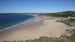 Sandy beach blue sea and waves in summer The Gower peninsula Wales Stock Footage