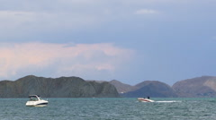 Two Boats Floating In The Sea At Mountains Stock Footage