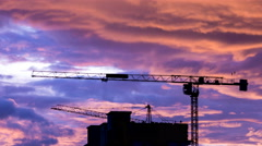 Silhouette Crane Working In Construction Site And Twilight Sky Stock Footage
