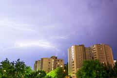 Lightning near buildings Stock Photos