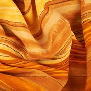 Fragment of an orange fabric - stock photo