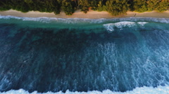 Aerial tropical island ocean waves - stock footage