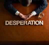 Word Desperation and devastated man composition - stock photo