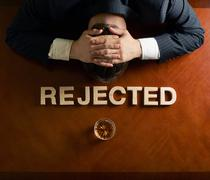 Word Rejected and devastated man composition - stock photo