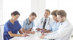 group of doctors meeting at seminar in hospital - stock footage