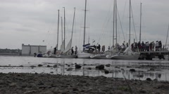 Small yachts docked in the yacht club of river background of city  4k Stock Footage