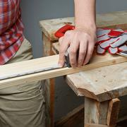 Taking the measurements of the wooden board Stock Photos
