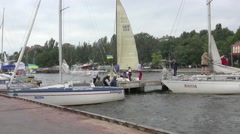 Editorial: Yacht with white sails in competition, against backdrop of city, 2015 Stock Footage