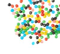 Multiple ball candies spilled over the surface - stock photo
