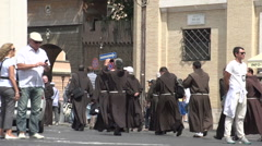 Priests walk to the St. Peter's Basilica - stock footage