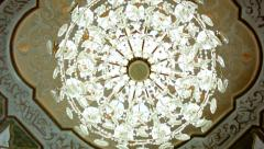 Beautiful hanging crystal chandelier on ceiling Stock Footage