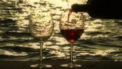 Pouring Wine into Glasses at Sunset Stock Footage