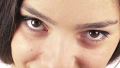 Beautiful young woman wearing subtle makeup blinking her eyes, close up view Stock Footage
