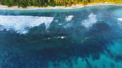 Tropical island aerial ocean waves - stock footage