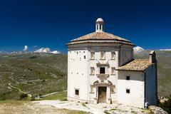 Santa Maria della Pieta Calascio Corno Grande behind Gran Sasso Abruzzo Italy Stock Photos