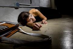 Crime Victim on the Street Floor - stock photo