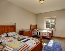 Kids' bedroom with twin beds and boy decor. - stock photo