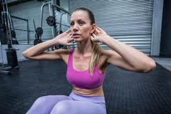 Stock Photo of Muscular woman doing abdominal crunch