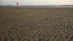 Girl Walking on the Sandy Beach at Sunset - stock footage