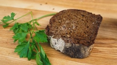 Lubricate the black bread with butter Stock Footage