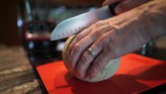 Whole cantaloupe cut with knife Stock Footage