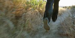 4K Tight shot following girl trail runner in California mountains Stock Footage