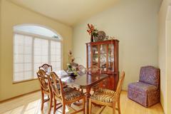 Elegant yet simple dinning room with hardwood floor. Stock Photos