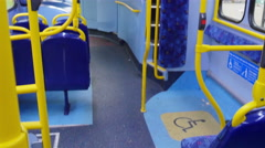 Blue and yellow colors inside the London bus Stock Footage