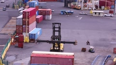 HONOLULU, HAWAII - JULY 2015: Fork Lift moving Shipping Containers around dock Stock Footage